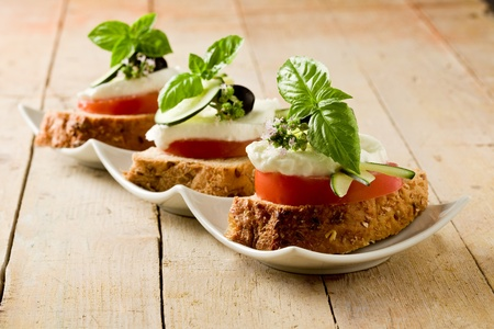 bruschetta: delicious sliced cereal bread with tomato mozzarella