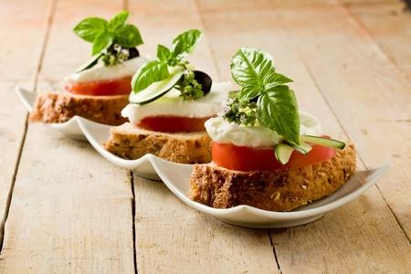 mediterranean food: delicious sliced cereal bread with tomato mozzarella