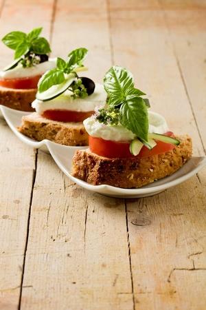 delicious sliced cereal bread with tomato mozzarella  photo