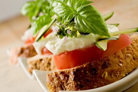 delicious sliced cereal bread with tomato mozzarella