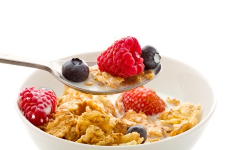 cornflakes: delicious breakfast isolated on white made of corn flakes with berries and fresh milk