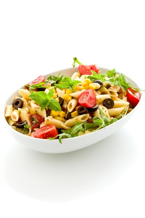 pasta salad: photo of delicious tasty pasta salad with fresh vegetables on isolated background