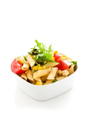 corn salad: photo of delicious tasty pasta salad with fresh vegetables on isolated background
