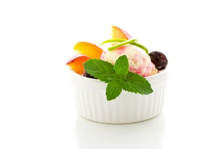photo of Ice cream with fruits on isolated white background Stock Photo - 10099731