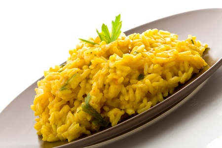 photo of delicious risotto with saffron on isoalated background Stock Photo