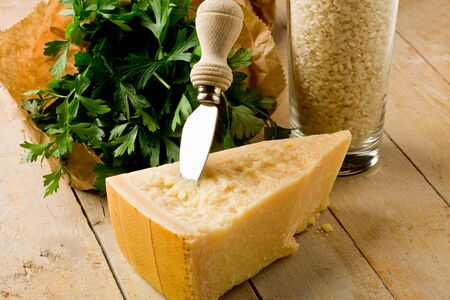parmesan cheese: photo of delicious fresh ingredients for preparing risotto dish with grana cheese