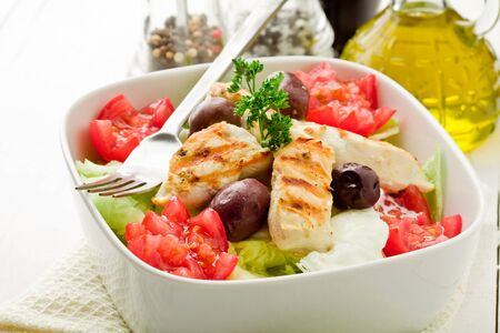 woden: photo of delicious chicken salad on white woden table