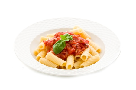 pasta isolated: photo of delicious pasta with basil and tomato sauce on white background