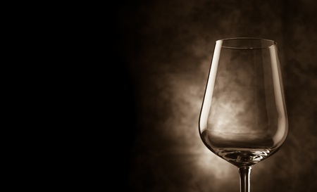 alcoholic beverages: photo of wine glass cover in fronto of rural background