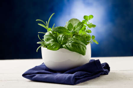 photo of delicious different herbs inside a bowl ready to be processed photo