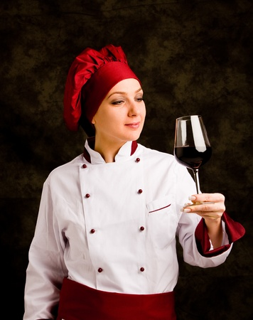 photo of young successfull female chef somelier with wine  photo