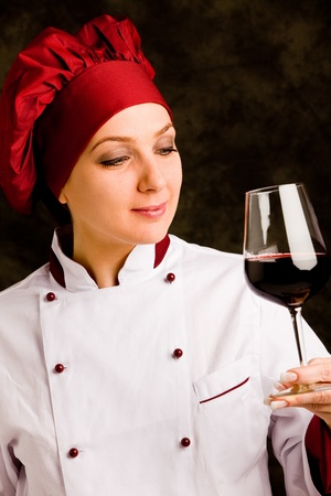 successfull: photo of young successfull female chef somelier with wine  Stock Photo