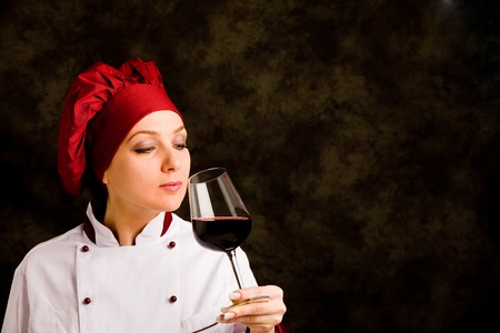 photo of young successfull female chef somelier with wine  Stock Photo - 10951706