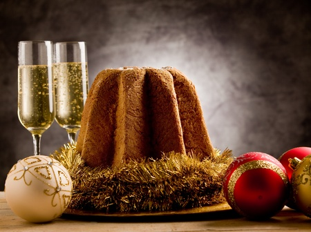 photo of delicious italian christmas panettone cake with champagne glass photo