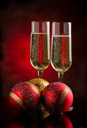 uncork: photo of christmas new year champagner glasses in front of rural background