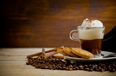 photo of delicious cappuccino on coffee beans with biscuits Stock Photo - 11060284