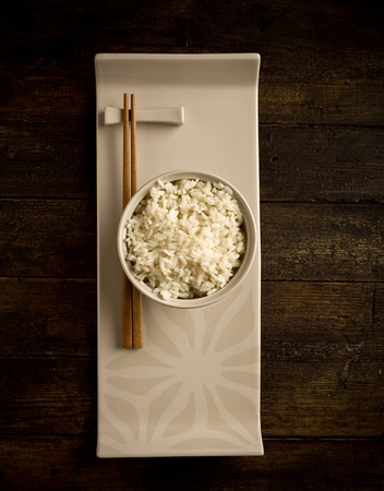 chopstick: photo of delicious rice inside white bowl with chopstick