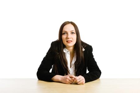 high school teacher: photo of female teacher sitting at her desk in front of a blackboard