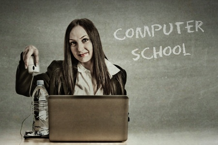 conceptual photo of woman who doesnt understands computer Stock Photo