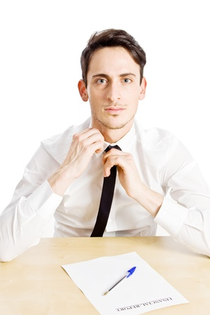 conceptual photo of nervous business man playing with his tie photo
