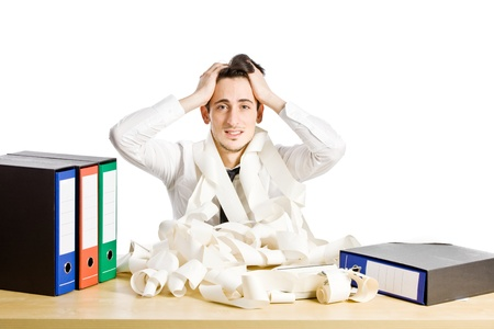 office chaos: conceptual photo of man sitting at his desk who is in crisis Stock Photo