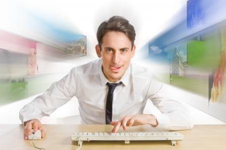 photo of young man with tongue surfing very fast the web Stock Photo