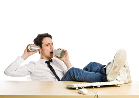 conference call: conceptual photo of man with tin phone making a phone call