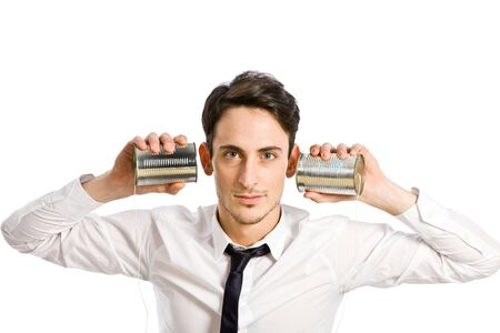 conceptual photo of man with two tin phones simulating conference call photo