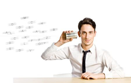 photo of young man holding a tin phone and listening Stock Photo - 11208337