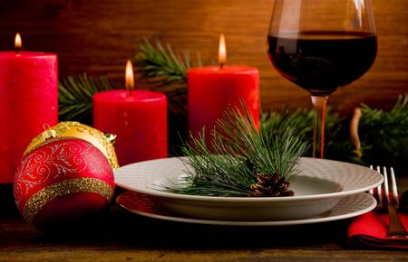 photo of wooden table with christmas ornaments illuminated by spot photo