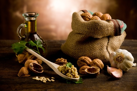 photo of delicious fresh ingredients for walnut pesto on wooden table photo