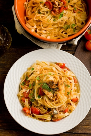 Italian regional dish made of pasta with sardines on wooden table photo