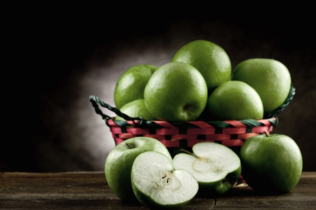 photo of green apples on wooden table in antique picturesque style Stock Photo