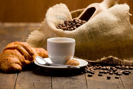 Photo of delicious hot espresso coffee on wooden table photo