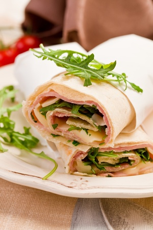 tortillas: Delicious tortillas stuffed with bacon and colorful arugula salad