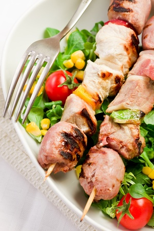 broiled: delicious broiled meat skewers on white table