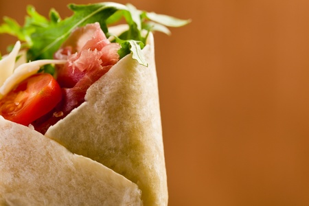 Delicious tortillas stuffed with bacon and colorful arugula salad Stock Photo - 11969195