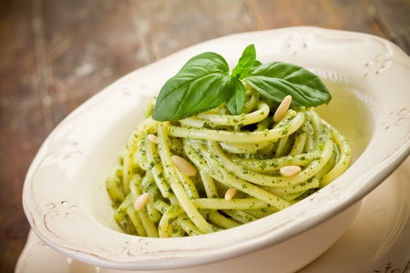 Delicious italian pasta with ligurian pesto and pine nuts Stock Photo