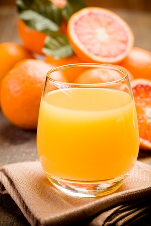 fresh squeezed orange juice on ancient wooden table photo
