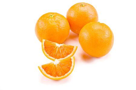 wedge: closeup photo of delicious fresh oranges on white background