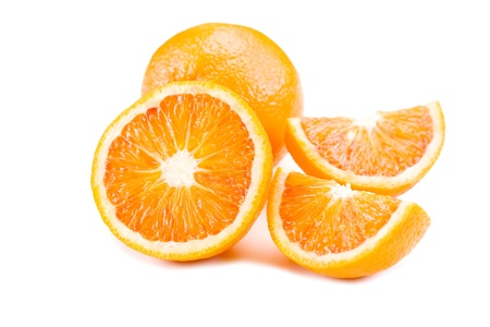 wedges: closeup photo of delicious fresh oranges on white background