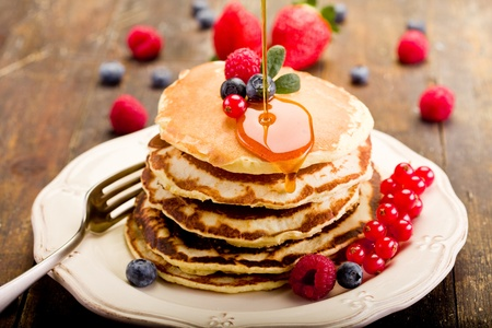 delicious pancakes on wooden table with fruits  Stock Photo - 12323706