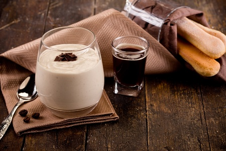 photo of delicious homemade and decomposed tiramisu on wooden table photo