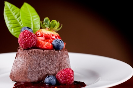 photo of delicious chocolate panna cotta with berries photo
