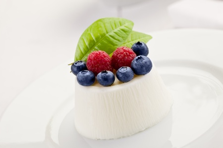 photo of delicious panna cotta with berries on whitetable Stock Photo - 12527040