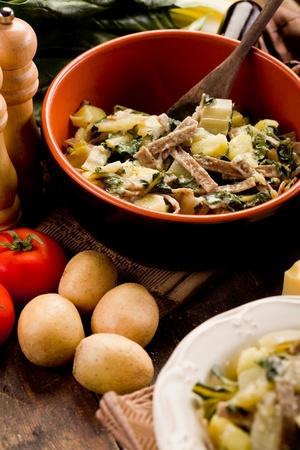 North Italian Regional pasta dish called pizzoccheri on wooden table  photo