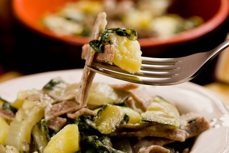 pizzoccheri: North Italian Regional pasta dish called pizzoccheri on wooden table