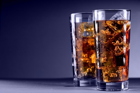 thirst quenching: Photo of delicious cold glass with cola and ice cubes Stock Photo