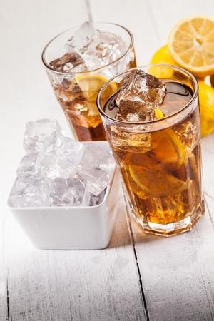 ice lemon tea: Photo of fresh lemon ice tea on white wooden table
