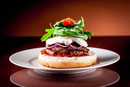 photo of delicious italian hamburger style with arugula and mozzarella photo